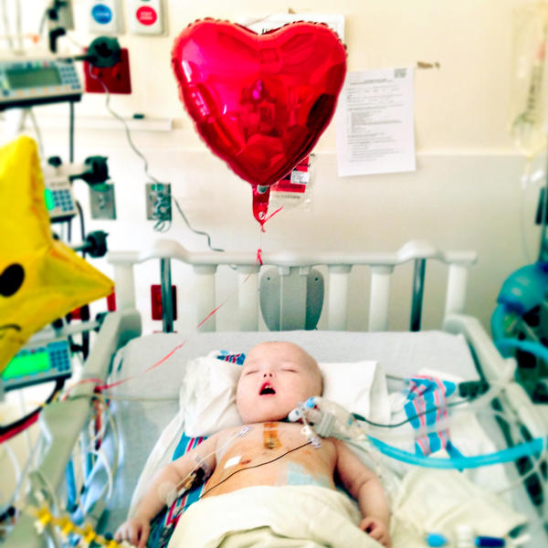 Garrett rests in his hospital bed on Valentine's Day, several weeks after his surgery.