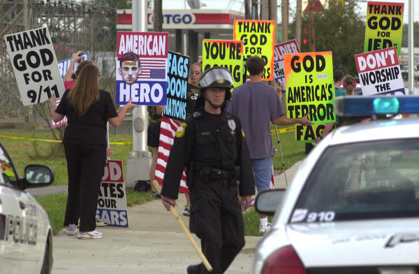 Westboro Baptist Church founder Fred Phelps is reportedly in hospice care in Topeka, Kan. Members of the church protest outside the gates at Fort Campbell, Ky., in this 2006 photo.