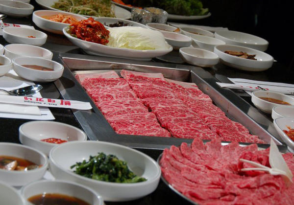 Gal bi, prime beef short rib, and Kobe style beef, Ggot sal, with all the side dishes, banchan. (Parks BBQ/Facebook)