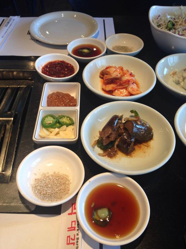 Small dishes of food (banchan) and accompaniments at Park BBQ. (Jeremy Hobson/Here & Now)