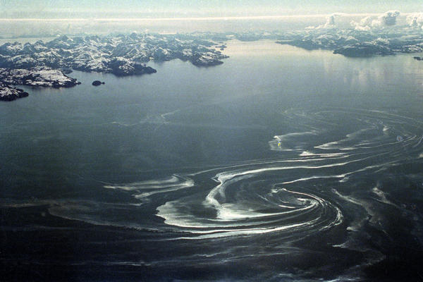 An oil slick swirls over Prince William Sound in 1989, about 50 miles from where the tanker ran aground. Towns in the region have developed new oil spill response plans in the years since the disaster.