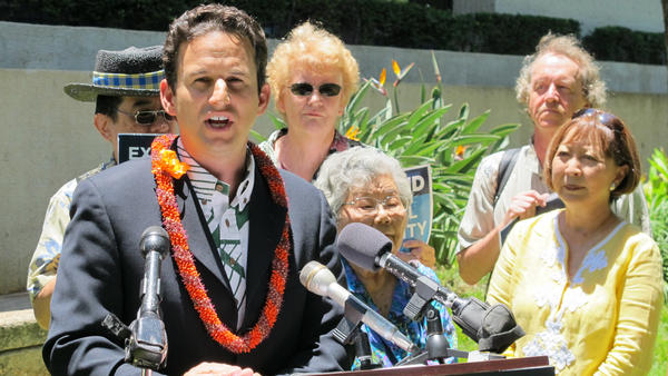 U.S. Sen. Brian Schatz of Hawaii speaks at a news conference in Honolulu in August.