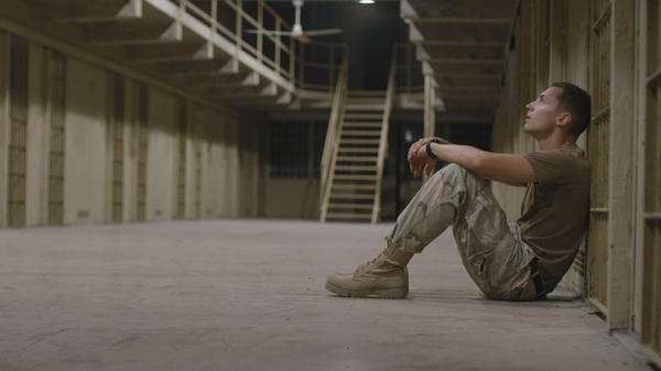 Jack Farmer (Luke Moran), a kind-hearted member of the Military Police stationed at Abu Ghraib, finds himself questioning the jail's culture.
