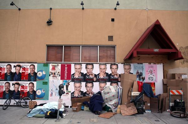 Homeless people camp in front of an out of business Trader Vic's restaurant on January 11, 2011 in San Francisco, California. An new app connects homeless people in the city -- many of whom have mobile phones -- to services, such as shelters and food. (Justin Sullivan/Getty Images)