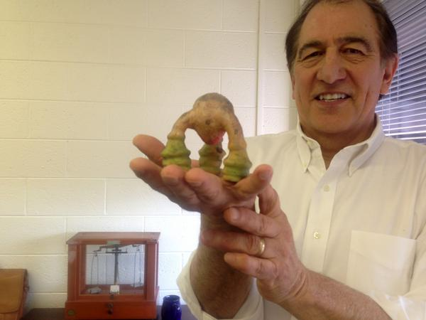 David Aguilar holds up one of his creations. (Robin Young)