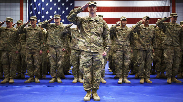 "As the U.S. winds down the Afghan war, the government is eyeing a much reduced military force — to its lowest level since World War II. Here, soldiers from the U.S. Army's 3rd Brigade Combat Team, 1st Infantry Division, salute during the playing of ""The Star-Spangled Banner"" during a homecoming ceremony Feb. 27 in Fort Knox, Ky."