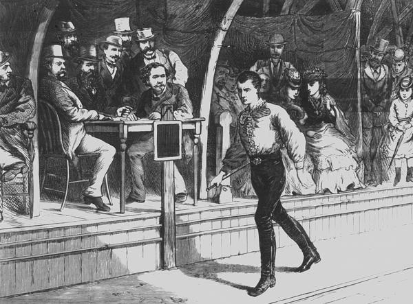 "<strong>Walking The Walk:</strong> Fans look on as pedestrian Edward Payson Weston walks at a New York City roller rink in 1874. His unique stride was described as ""wobbly."""