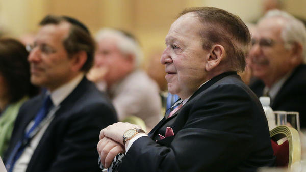 Sheldon Adelson listens as New Jersey Gov. Chris Christie speaks during the Republican Jewish Coalition meeting on March 29 in Las Vegas. Several possible GOP presidential candidates gathered in Las Vegas as Adelson, a billionaire casino magnate, looks for a new favorite to help on the 2016 race for the White House.
