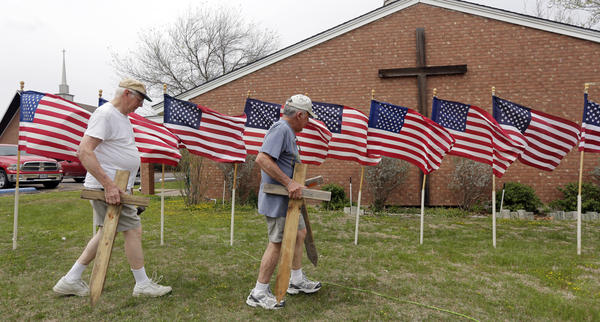 Bob Butler (left) and Bob Gordon work on a memorial Thursday at Central Christian Church in  Killeen, Texas, for the victims of the Fort Hood shooting.
