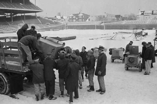 Staff unload hot-air devices to help soften the frozen playing field in 1963. The New York Giants and the Chicago Bears would play there for the NFL championship.