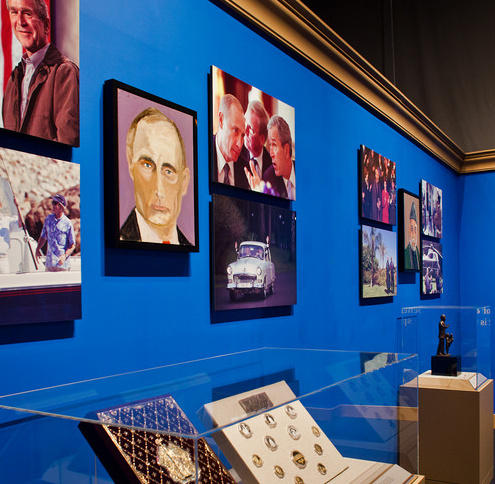 Former President George W. Bush's portraits include one of Russian President Vladimir Putin. The exhibition at the George W. Bush Presidential Center in Dallas includes mementos from Bush's time in office.