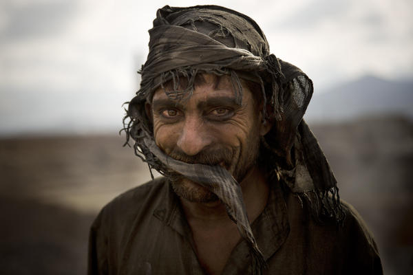 Afghan day laborer Zekrullah, 23, takes a break after preparing kilns to fire the bricks at a factory on the outskirts of Kabul in 2013. The photo was taken by Associated Press photographer Anja Niedringhaus, who was killed while covering elections in Afghanistan on Friday.