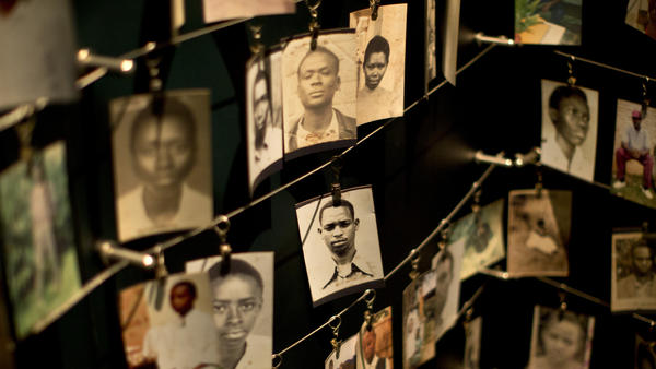 Family photographs of some of those who died hang in a display in the Kigali Genocide Memorial Centre in Rwanda's capital on Saturday.