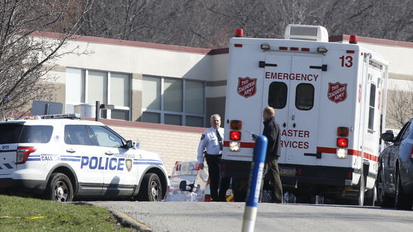 Emergency responders gather in the parking lot on the campus of Franklin Regional High School in Murraysville, Pa., on Wednesday after an attack there left at least 20 people, nearly all of them students, injured. Most suffered stab wounds or lacerations.