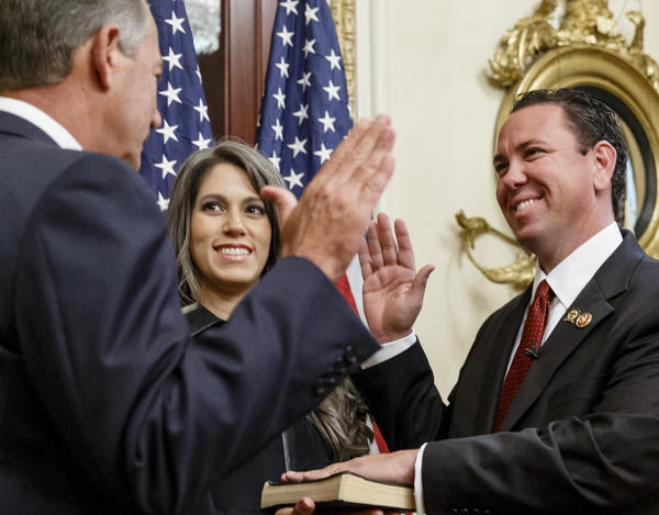 Rep. Vance McAllister, R-La., in happier days with his wife, Kelly, and House Speaker John Boehner, who swore in the new congressman last year.