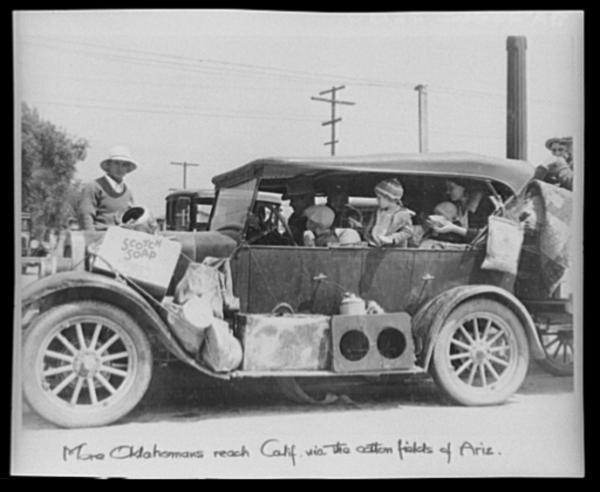 "Oklahoma Dust Bowl refugees in San Fernando, Calif. (1935). Steinbeck writes: ""Suddenly they were nervous. Got to get out quick now. Can't wait. We can't wait. And ... frantically they loaded up the cars and drove away, drove in the dust. The dust hung in the air for a long time after the loaded cars had passed."""
