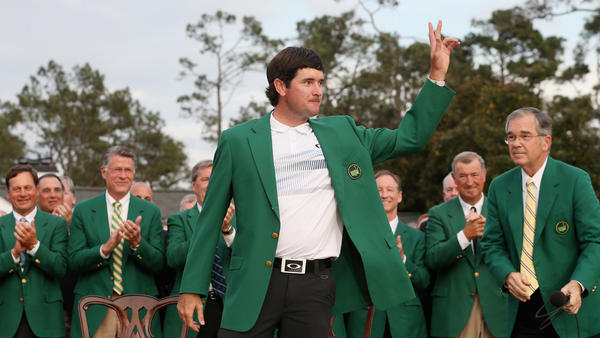 Bubba Watson poses with the green jacket after winning the 2014 Masters Tournament by a three-stroke margin at Augusta National Golf Club in Augusta, Ga., on Sunday.