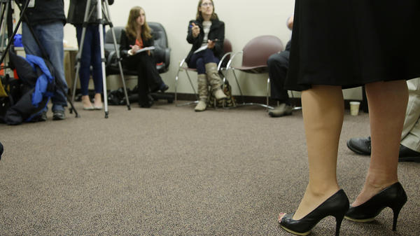 "Heather Abbott of Newport, R.I., shows off her ""high-definition"" prosthetic leg, which allows her to wear high heels and skirts."