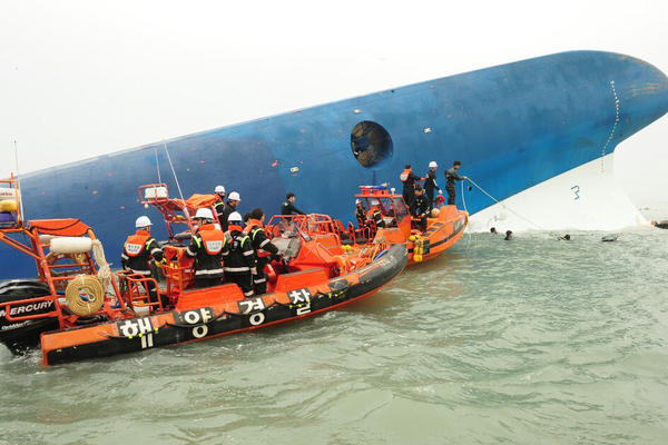 Members of South Korea's coast guard search for survivors.