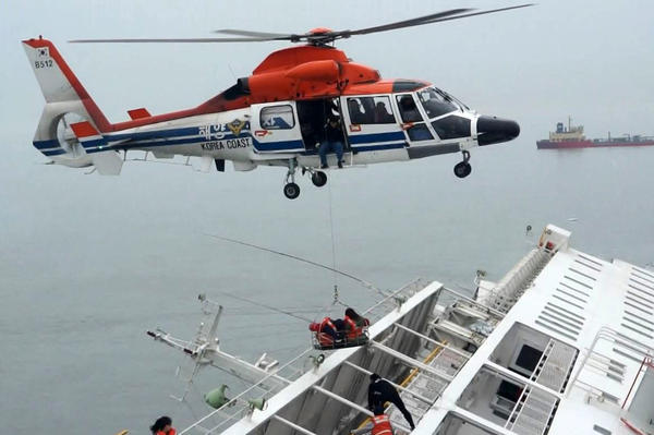 A maritime police helicopter was used in the rescue efforts. According to NPR's Anthony Kuhn, most of the ship was under water about two hours after rescuers arrived.