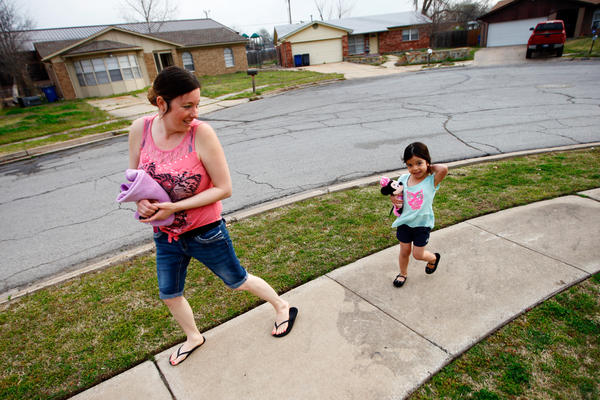 Tiffany Contreras walks her daughter Kyndall, 4, to preschool at Disney Elementary in Tulsa, Okla.