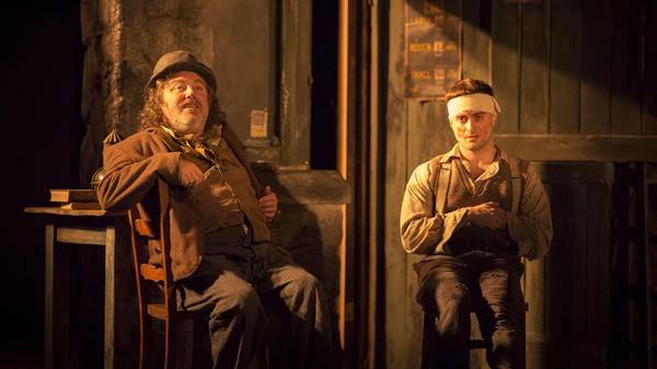 Daniel Radcliffe (right) plays Billy, in a scene with Pat Shortt as Johnnypateenmike, in the Broadway production of Martin McDonagh's <em>The Cripple of Inishmaan</em>.