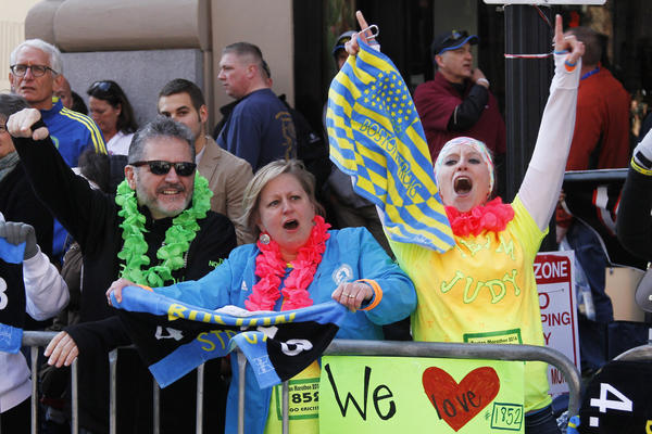 Fans cheer near the finish line.