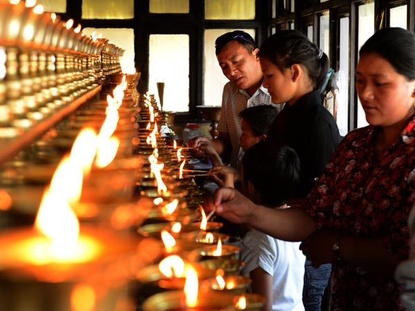 Family members of the Mount Everest avalanche victims were lighting oil lamps Sunday at a Sherpa Monastery in Katmandu, Nepal.