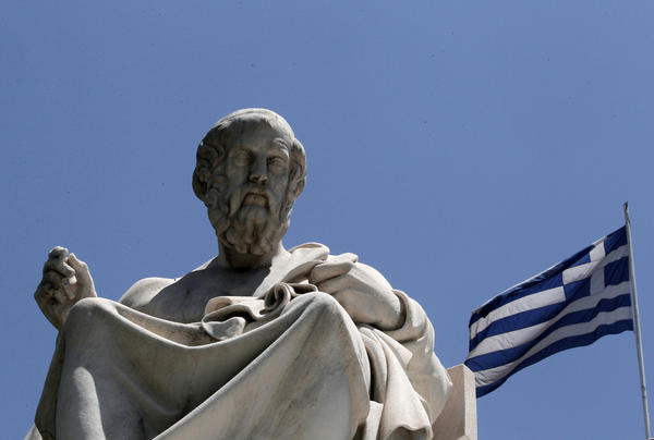 A marble statue of ancient Greek philosopher Plato stands in front of the Athens Academy, in Athens. (Dimitri Messinis/AP)