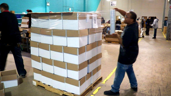 Workers shrink-wrap products at the Sertoma Centre outside Chicago. Sertoma provides employment opportunities to about 250 people with disabilities through subcontracting jobs.