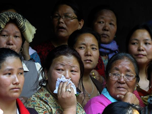 Relatives of a Mount Everest avalanche victim grieve during a cremation ceremony in Katmandu on Monday.