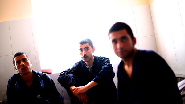 Saleh (from left), 25, Mohammed Ibrahim, 31, and Nisar Ahmed, 23, sit in a drug rehabilitation center on the outskirts of Herat. Opium grown in Afghanistan has long been smuggled through Herat on its way to Iran and to the West. Now Herat has many drug addicts of its own.