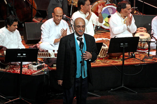 Izzat Majeed address a crowd in New York during a collaborative concert between Sachal Studios musicians and the Jazz at Lincoln Center Orchestra. The Lahore-born philanthropist founded a recording studio and provided opportunities for musicians in Pakistan.