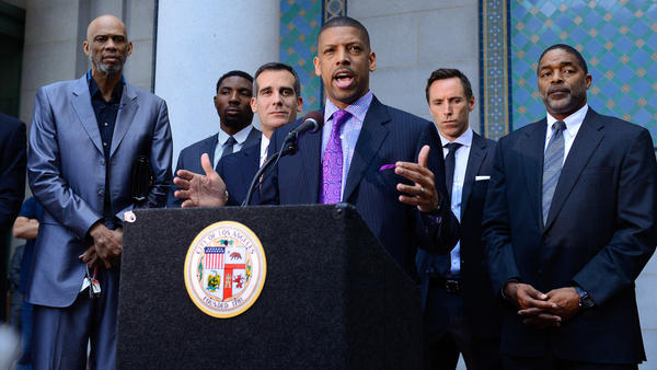 Former and current NBA players (from left) Kareem Abdul-Jabbar and Roger Mason, along with Los Angeles Mayor Eric Garcetti, Sacramento Mayor Kevin Johnson and the Lakers' Steve Nash and former Laker and Clipper Norm Nixon, welcome the NBA's ban of Clippers owner Donald Sterling Tuesday.