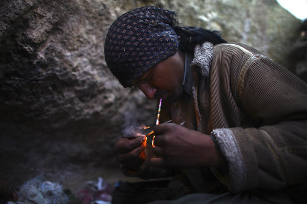 Ahmad, who wouldn't give his last name, smokes heroin. He lives in a makeshift village filled with drug addicts called Kamar Kulagh, on the outskirts of the western Afghan city of Herat.