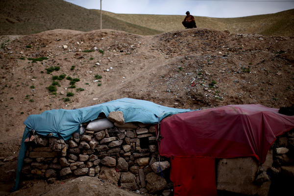 One of the many makeshift dwellings in Kamar Kulagh that consists only of piled stones and a tarp.