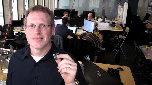 Steve Jungmann, vice president at the tech startup Quanttus, holds up an early prototype of the biometric sensors the company will use on its wearable products. The current version is much smaller.