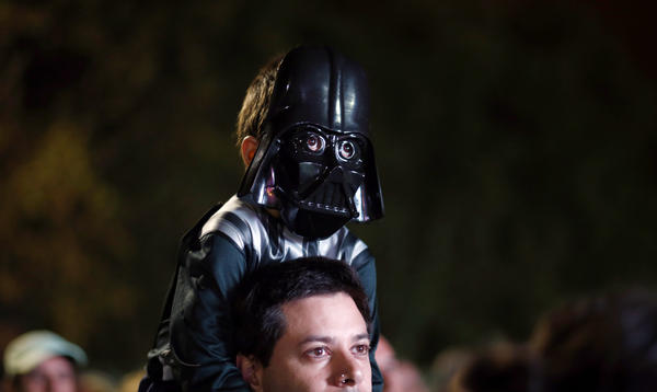 Argentina: A boy wears a Darth Vader mask as he awaits the <em>Star Wars</em> Run race in Buenos Aires on Saturday.