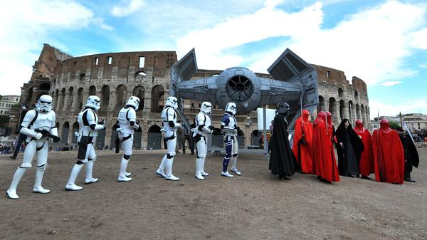 Fans dressed as storm troopers and Darth Vader march in front of the Colosseum in central Rome on May 4, Star Wars Day.