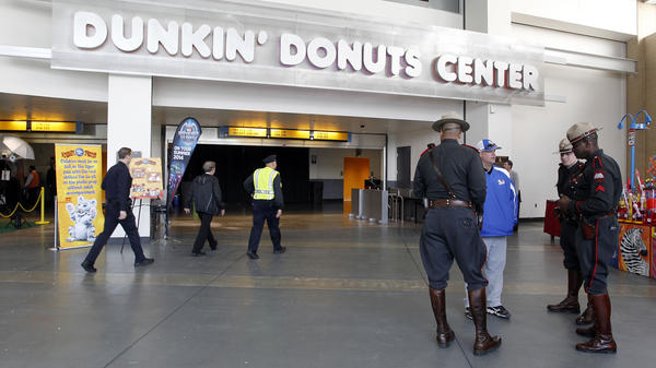 Rhode Island state troopers and Providence police stand in the lobby of the Dunkin' Donuts Center after an accident during the Ringling Bros. and Barnum & Bailey Circus performance Sunday.