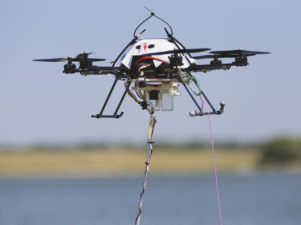 A water-collecting drone hovers at a testing site in Lincoln, Neb., in 2013. The Federal Aviation Administration is working on rules for the commercial use of unmanned aircraft.