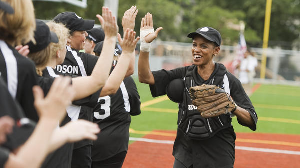 Rep. Donna Edwards, D-Md., plays in the annual Congressional Women's Softball game in 2011. She says it's hard to get more women to run for office.