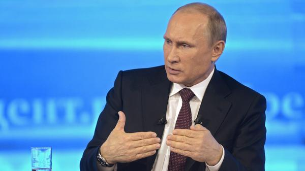 Russian President Vladimir Putin, shown speaking on TV last month, has signed a measure that would impose a host of restrictions on Internet companies and users.