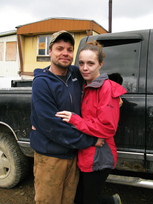 Frank and Amber Adams of Hammondsport, N.Y. He sometimes has to redeem empty soda cans to buy gas to take Amber to counseling classes.