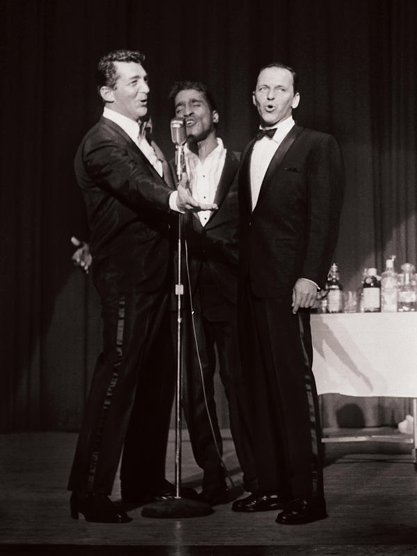 Frank Sinatra performing with Dean Martin and Sammy Davis Jr.