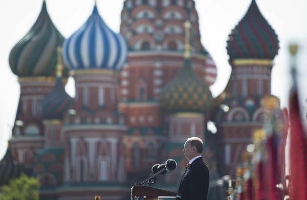 Russian President Vladimir Putin speaks during a Victory Day parade, which commemorates the 1945 defeat of Nazi Germany, with St. Basil's Cathedral in the background.