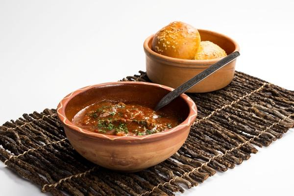 <em>Janija</em>, a tomato-based beef and vegetable stew that is eaten with bread, is one of cook Djevrija Mazrek's favorite dishes.