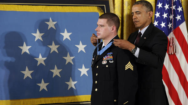 President Obama awards the Medal of Honor to former Army Sgt. Kyle White, who saved the life of a fellow soldier, called in U.S. airstrikes and helped evacuate the wounded during a firefight with the Afghan Taliban in 2007.