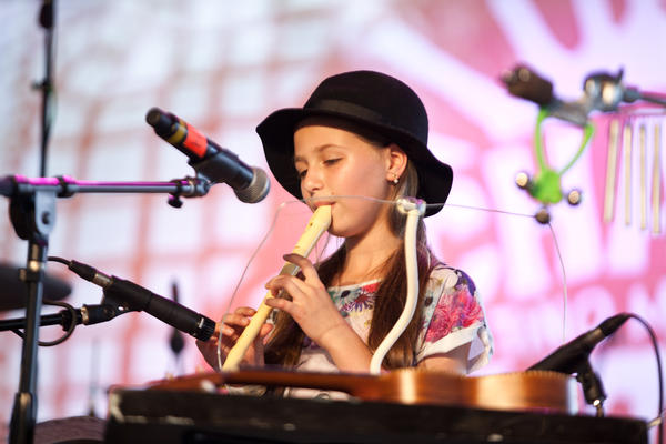 """Young Milah Schrader of the Colombian Depeche Mode cover band DMK, performing with her father and brother, brings the """"aww"""" factor."""