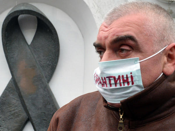 """The mask of this Kiev protester (at a 2012 demonstration demanding more funding for HIV treatment) reads """"quarantine."""" There are enough drugs to treat only half the HIV patients in Ukraine."""